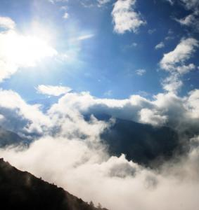 nepal Annapurna Conservation Area 73 Ngawal Clouds in Sun